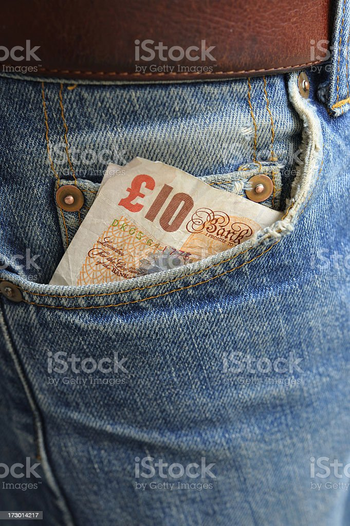Cash in Worn Denim Jeans Pocket series - ten pounds royalty-free stock photo
