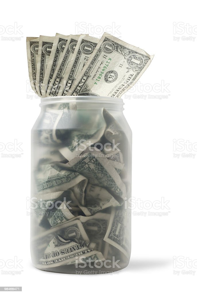 Cash jar with dollar bills royalty-free stock photo