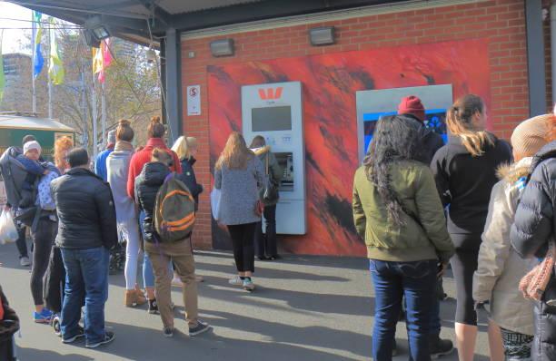 Cash machine ATM queue Melbourne Australia stock photo