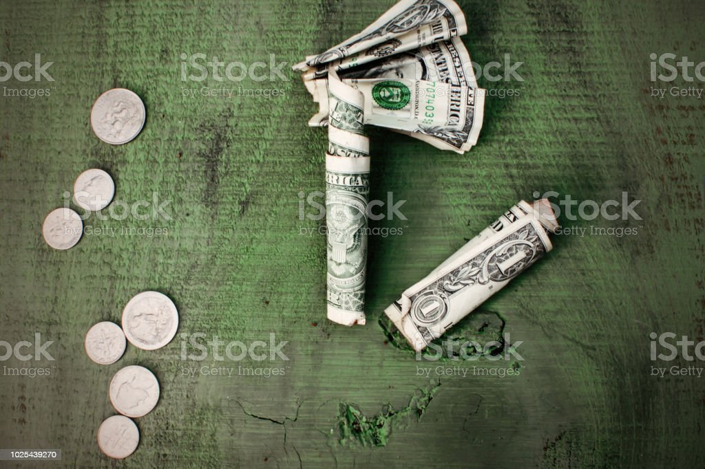 Cash Money Flat Lay growth business finance savings and budgeting dollar bills and spare change flat lay on rustic wood stock photo