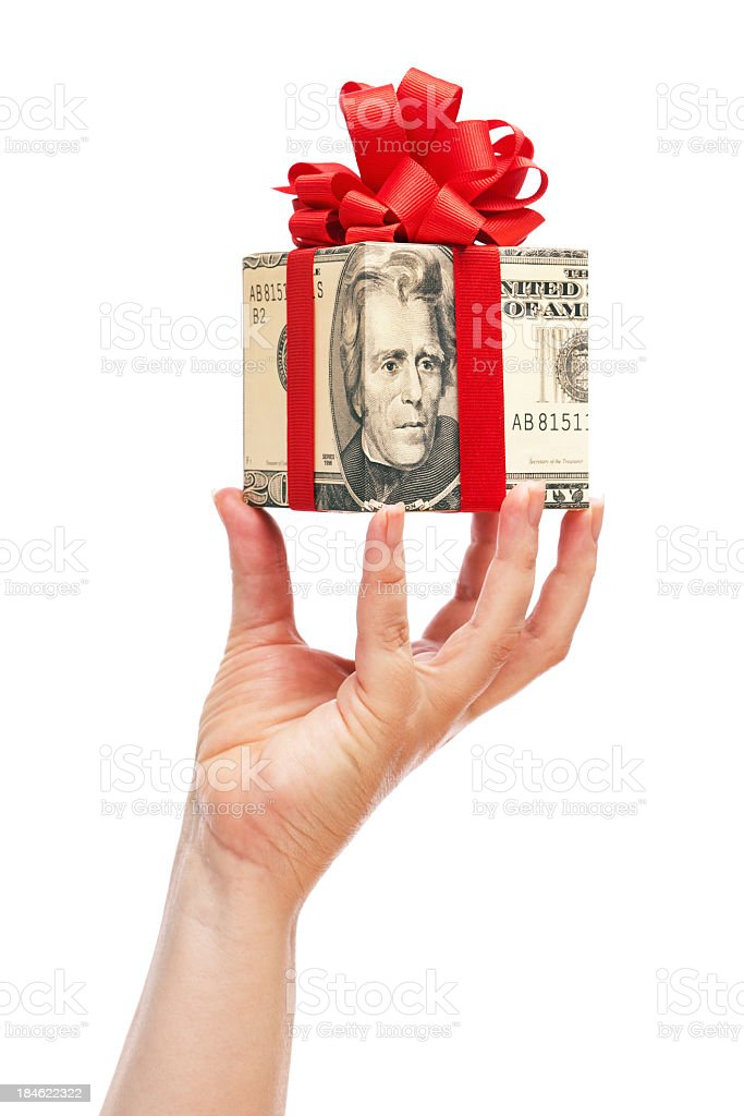 Cash Money Gift in Hand for Christmas on White Background royalty-free stock photo