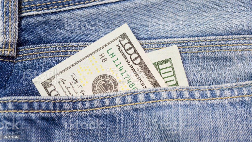 Cash, money is in the pocket of blue jeans stock photo