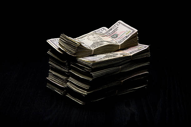 cash money - money black background stock photos and pictures