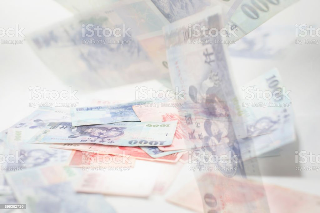 Cash money Taiwan dollars and money falling or floating blur affect. stock photo