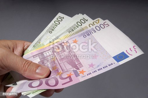 Euro money in hand. Simple shop of a hand holding money.