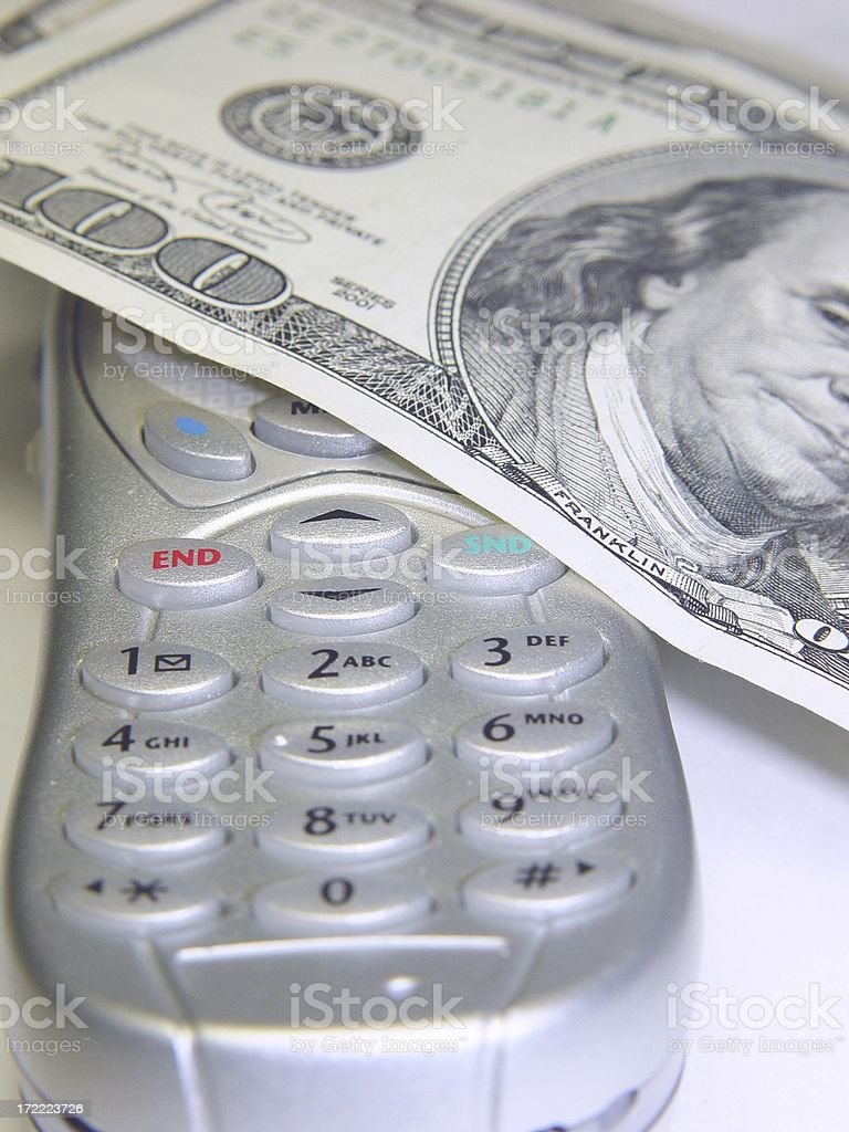 Cash on phone 100 dollar bill stock photo