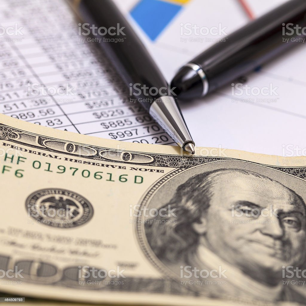 Cash, pen and financial report royalty-free stock photo