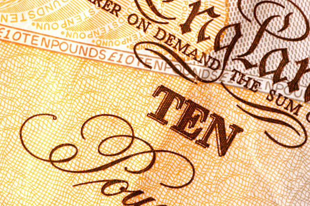 Cash Macro detail of a british ten pound note. ten pound note stock pictures, royalty-free photos & images