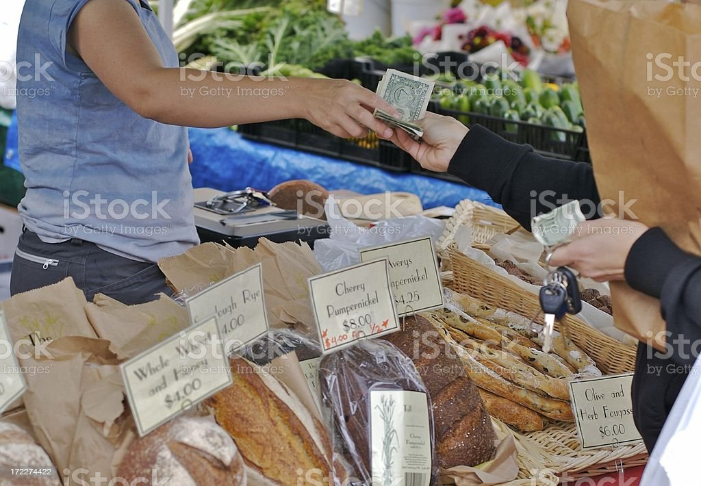 Cash purchase of fresh bread at farmers market royalty-free stock photo