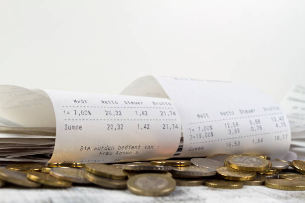 cash receipt with EURO coins stock photo