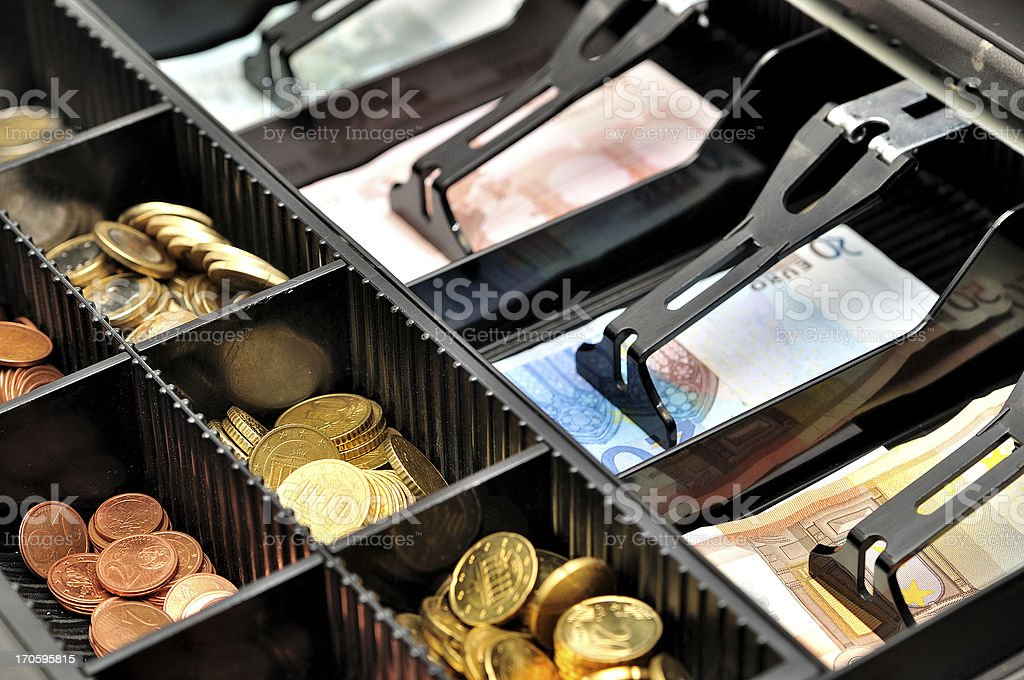 Cash register drawer holding euro currency stock photo