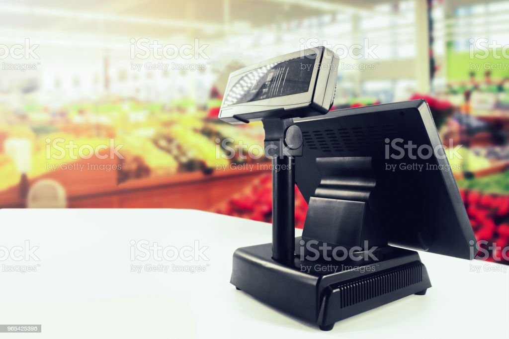 cash register on desk at grocery store royalty-free stock photo