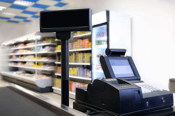 Cash register. Checkout counter at the grocery store. cash register stock pictures, royalty-free photos & images