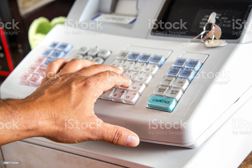 Cash register human hand using a cash register Business Stock Photo
