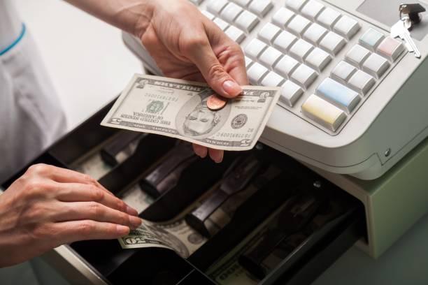 Cash register. Close-up of Cashier Using Cash Register cash register stock pictures, royalty-free photos & images