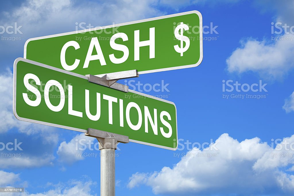 Cash Solutions Street Sign stock photo