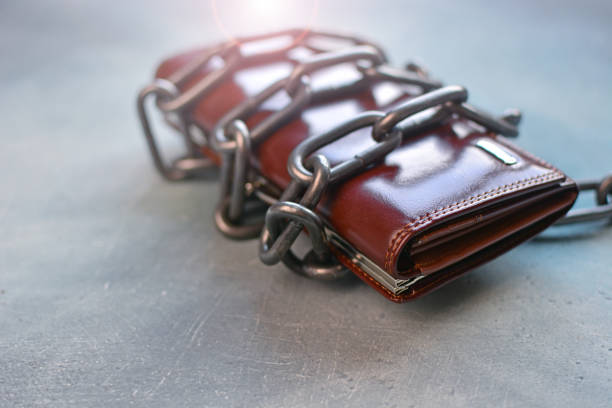 Cash spending limit  concept with chain wrapped wallet. Cash spending limit  concept with chain wrapped wallet. sanctions stock pictures, royalty-free photos & images