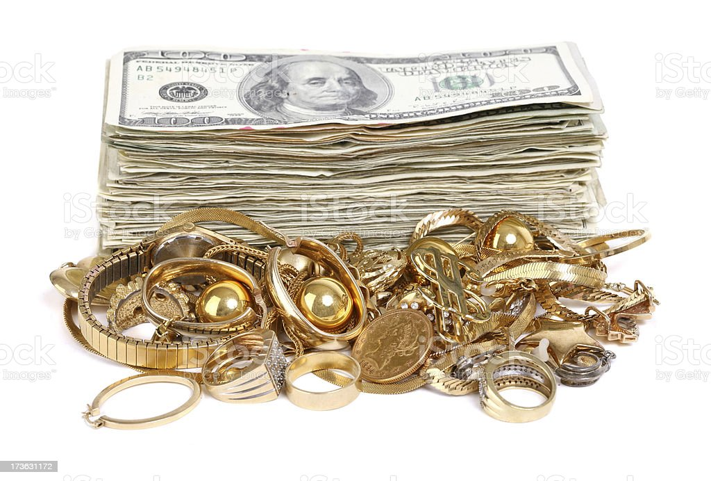 Cash Stack behind a pile of Scrap Gold royalty-free stock photo