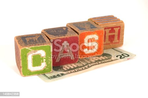 Children's blocks over top a $20 Bill