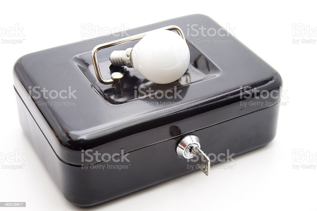 Cashbox with key and light bulb stock photo