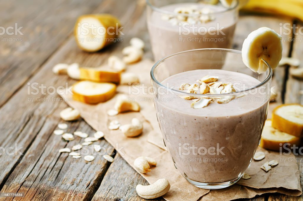 cashew banana cocoa oats smoothie stock photo