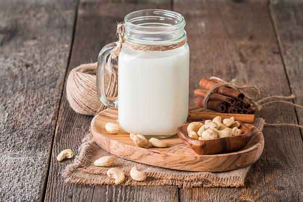 cashew nut vegan milk - cashew stock photos and pictures