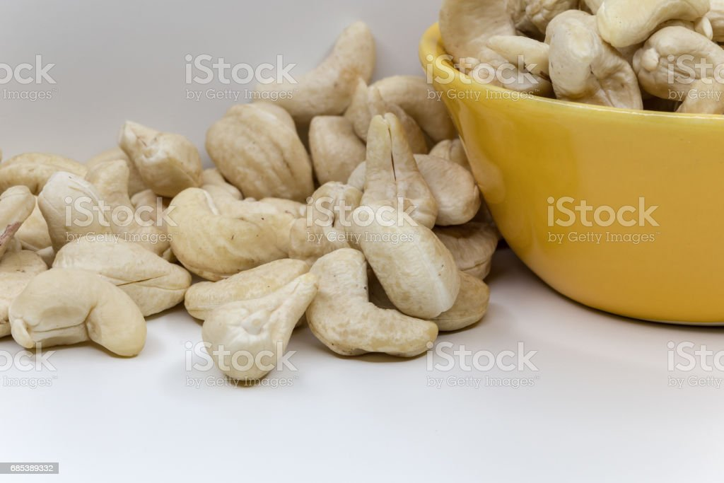 cashew nuts close up on white background royalty-free stock photo
