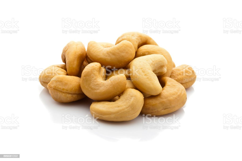 Cashew nuts heap isolated on white background - foto stock