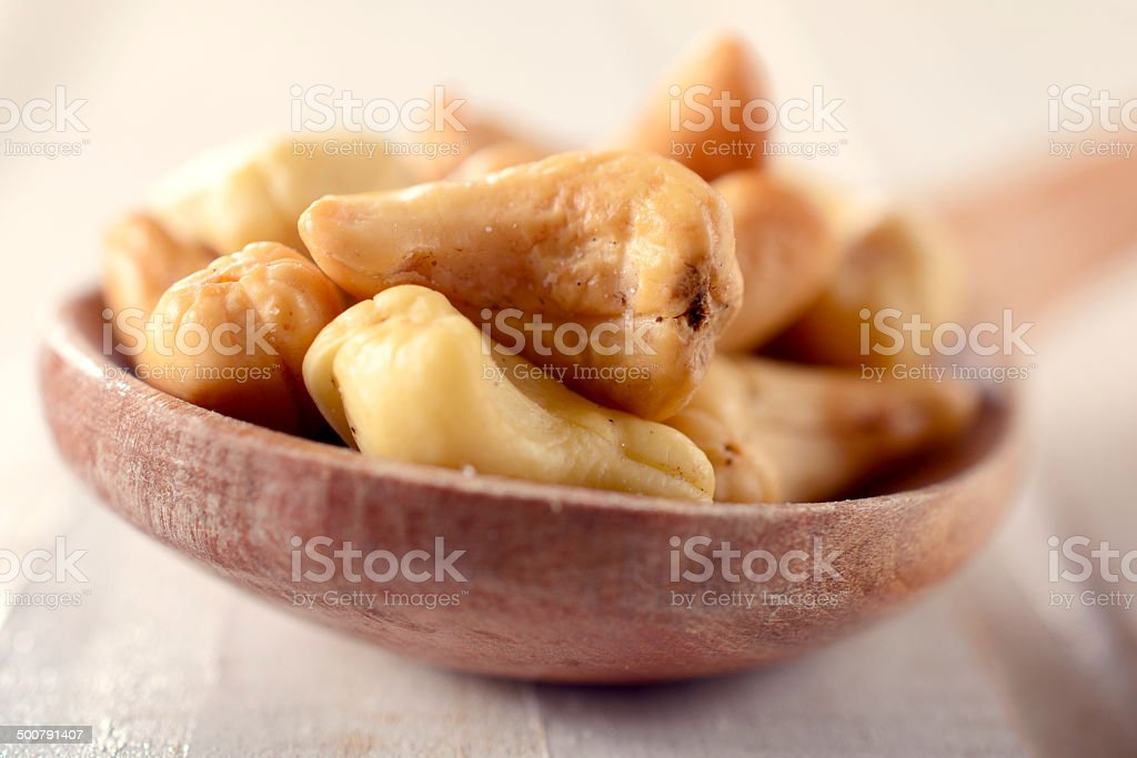 Cashew nuts in ladle stock photo