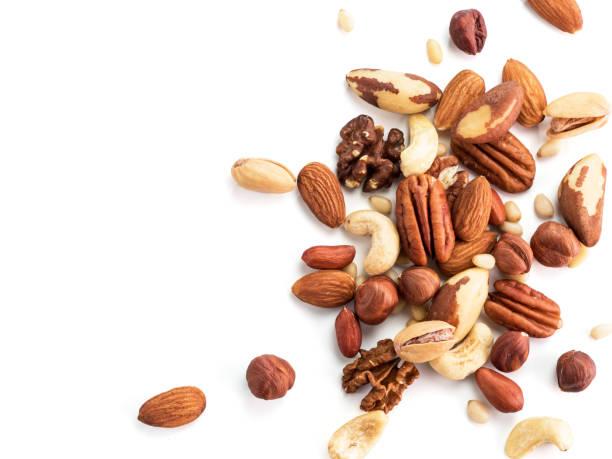 cashew, pecan, pine nuts, hazelnut isolated - nuts стоковые фото и изображения