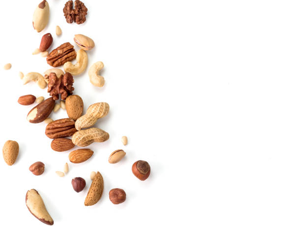 cashew, pecan, pine nuts, hazelnut isolated - nut food stock photos and pictures