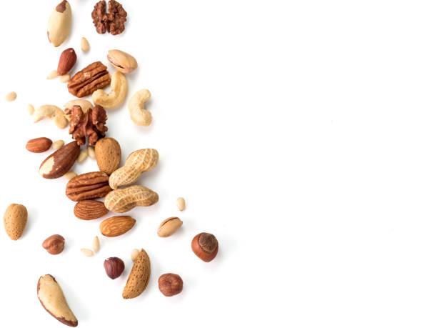 cashew, pecan, pijnboompitten, hazelnoot geïsoleerd - noot stockfoto's en -beelden