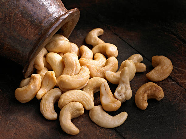 cashews - cashew stock photos and pictures