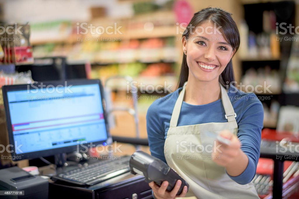 Cashier at the supermarket getting a card payment stock photo