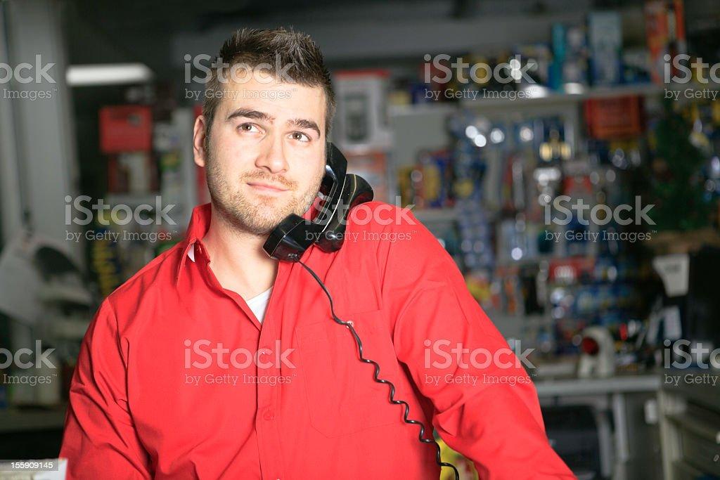 Cashier Hardware Store Talking on Phone royalty-free stock photo
