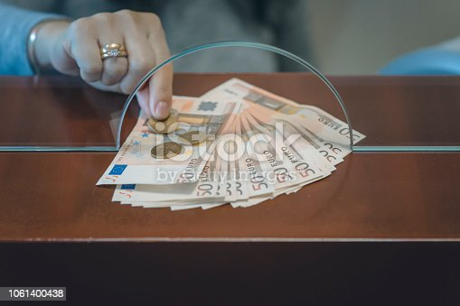 945598452 istock photo Cashier in the Bank - euro 1061400438