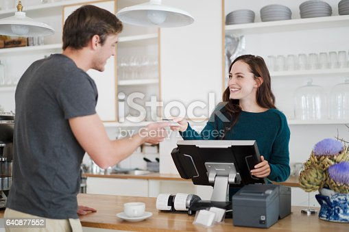 istock Cashier receiving payment from customer in cafe 640877552