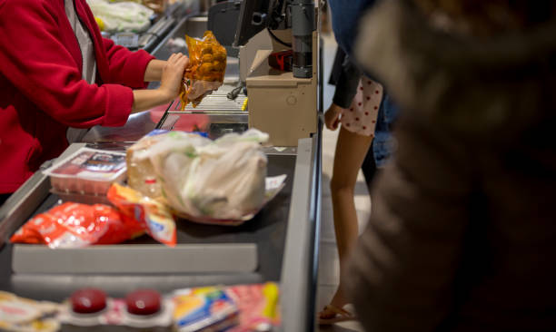 Cashier scans groceries stock photo
