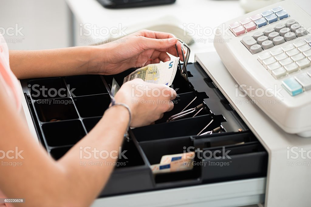Cashier Searching For Change In Cash Register Drawer stock photo