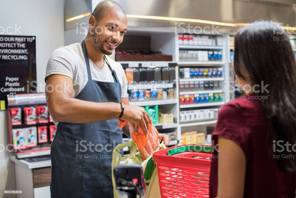 Cashier working at supermarket stock photo