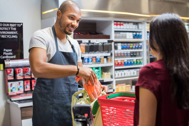 cashier working at supermarket - store counter stock photos and pictures