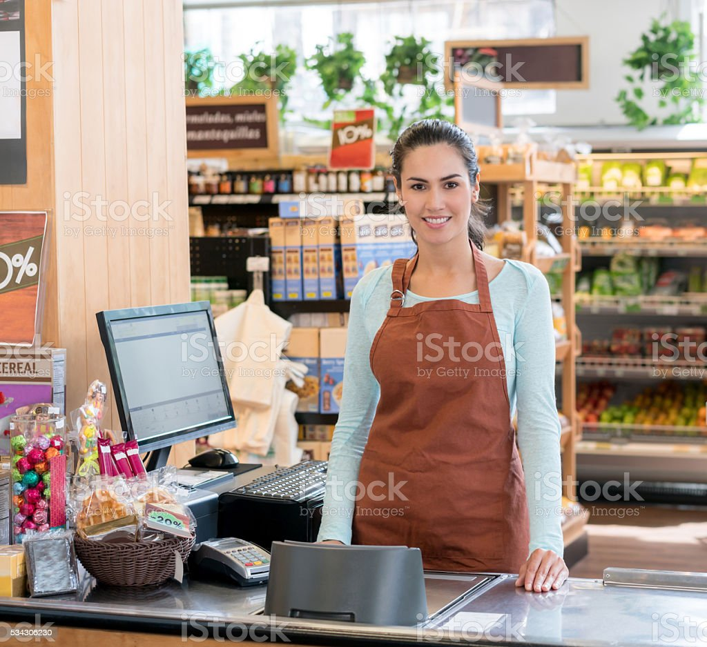 Cashier Working At The Supermarket Lizenzfreies Stock Foto