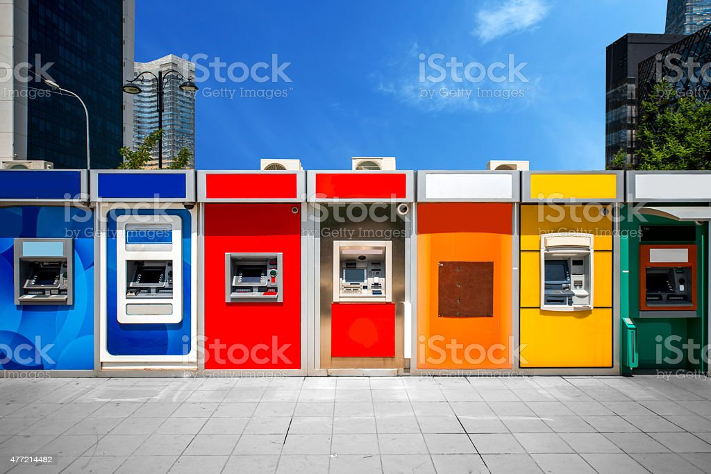 Cashpoint with colorful bankomats stock photo