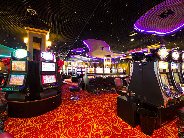 Casino at wait A Slot machines room in an empty  Casino. game of chance stock pictures, royalty-free photos & images