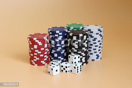 istock Casino chips and dice. 1034052074