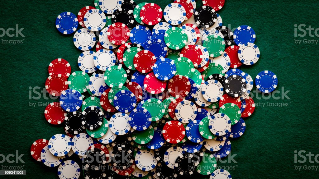 casino chips background on green table