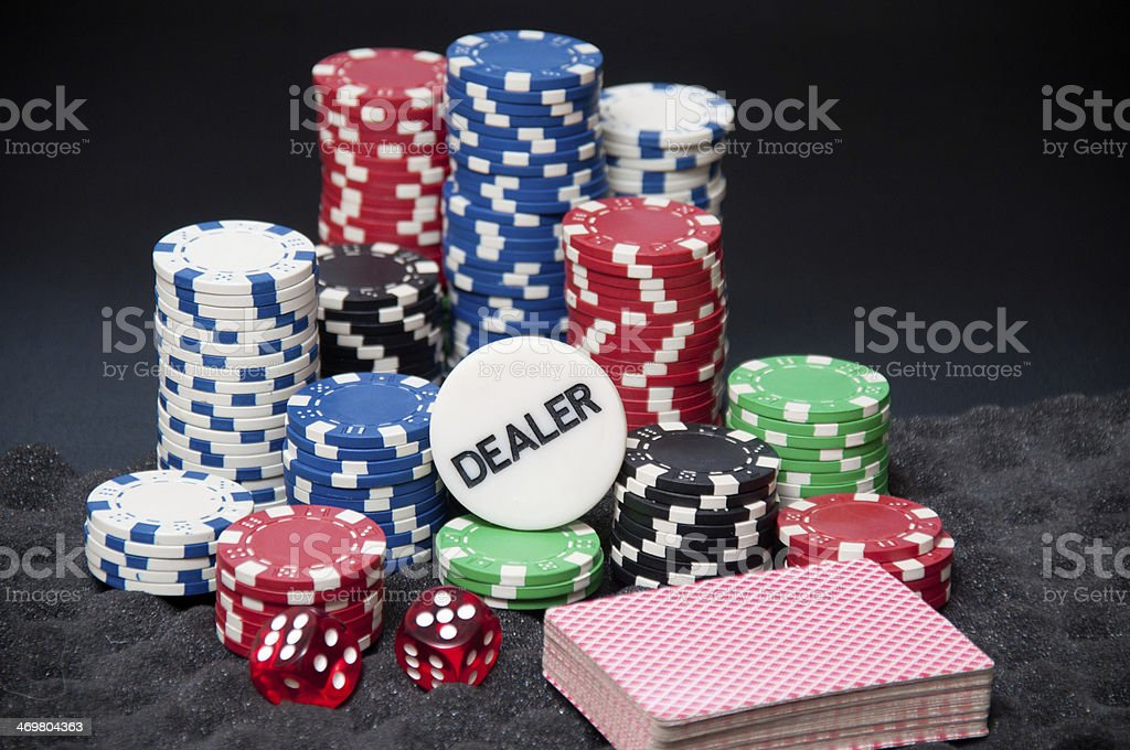 Casino chips, cards, dice and Dealer on top stock photo