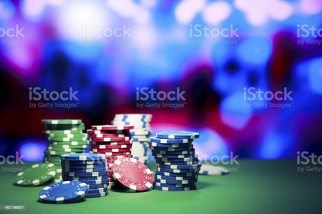 Casino chips on gaming table stock photo