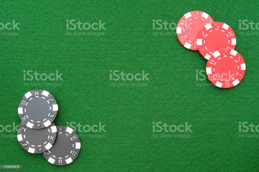 Casino chips on green felt stock photo