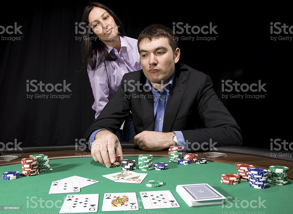 Casino chips on green felt royalty-free stock photo